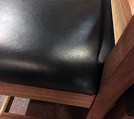 2 chairs with leather seat covers