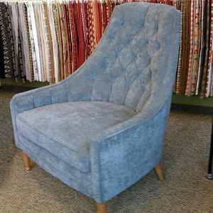 seattle tuffed armchair upholstered in velvet