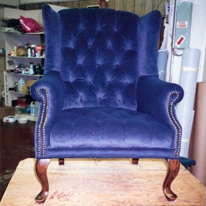 blue velvet wingback chair with nailhead trim